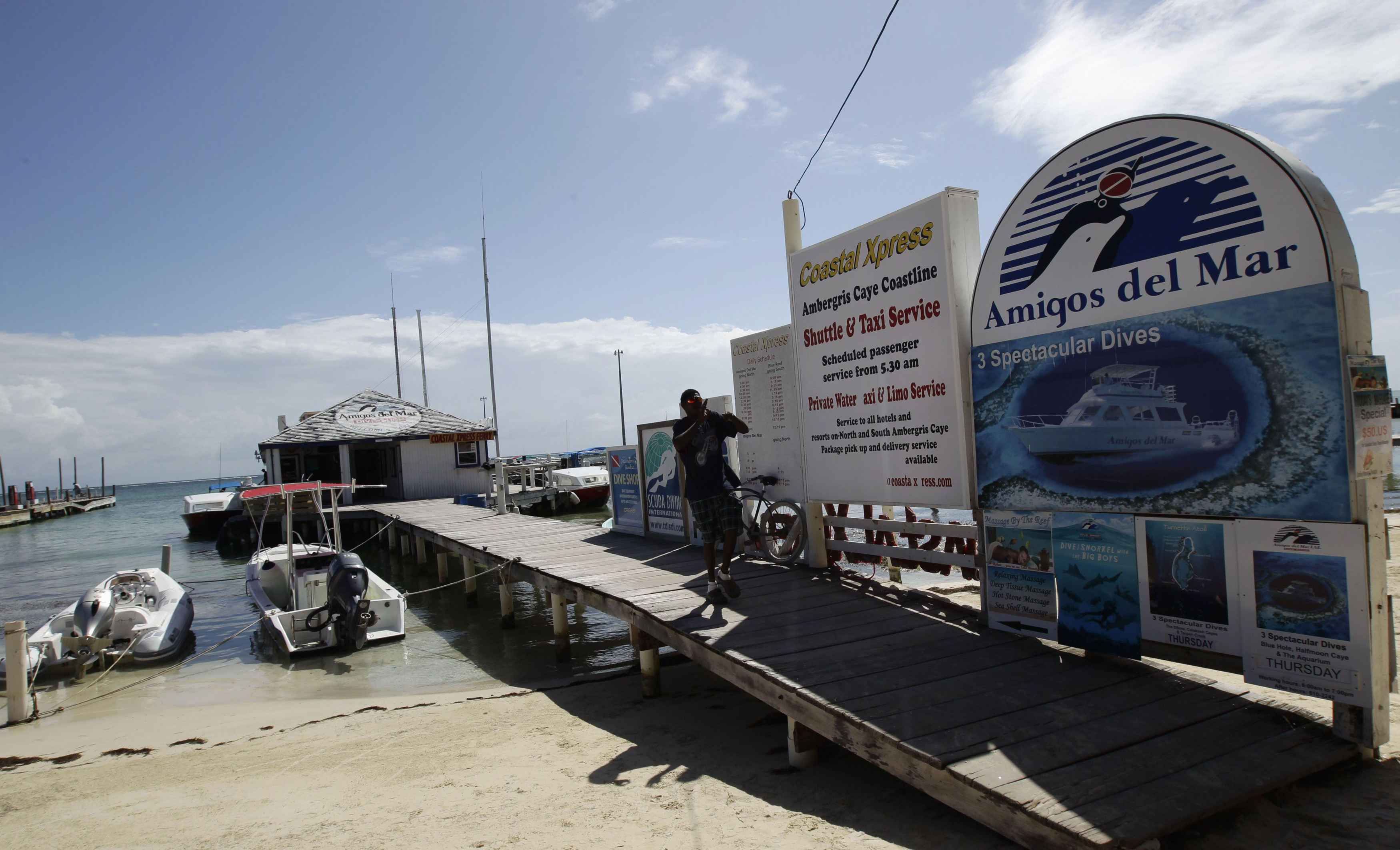 A man leaves a dock near the main square in San Pedro, Belize, November 15, 2012.