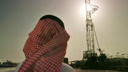 Khaled al Otaiby, an official of the Saudi oil company Aramco, watches progress at a rig at the al-Howta oil field near Howta, Saudi Arabia.