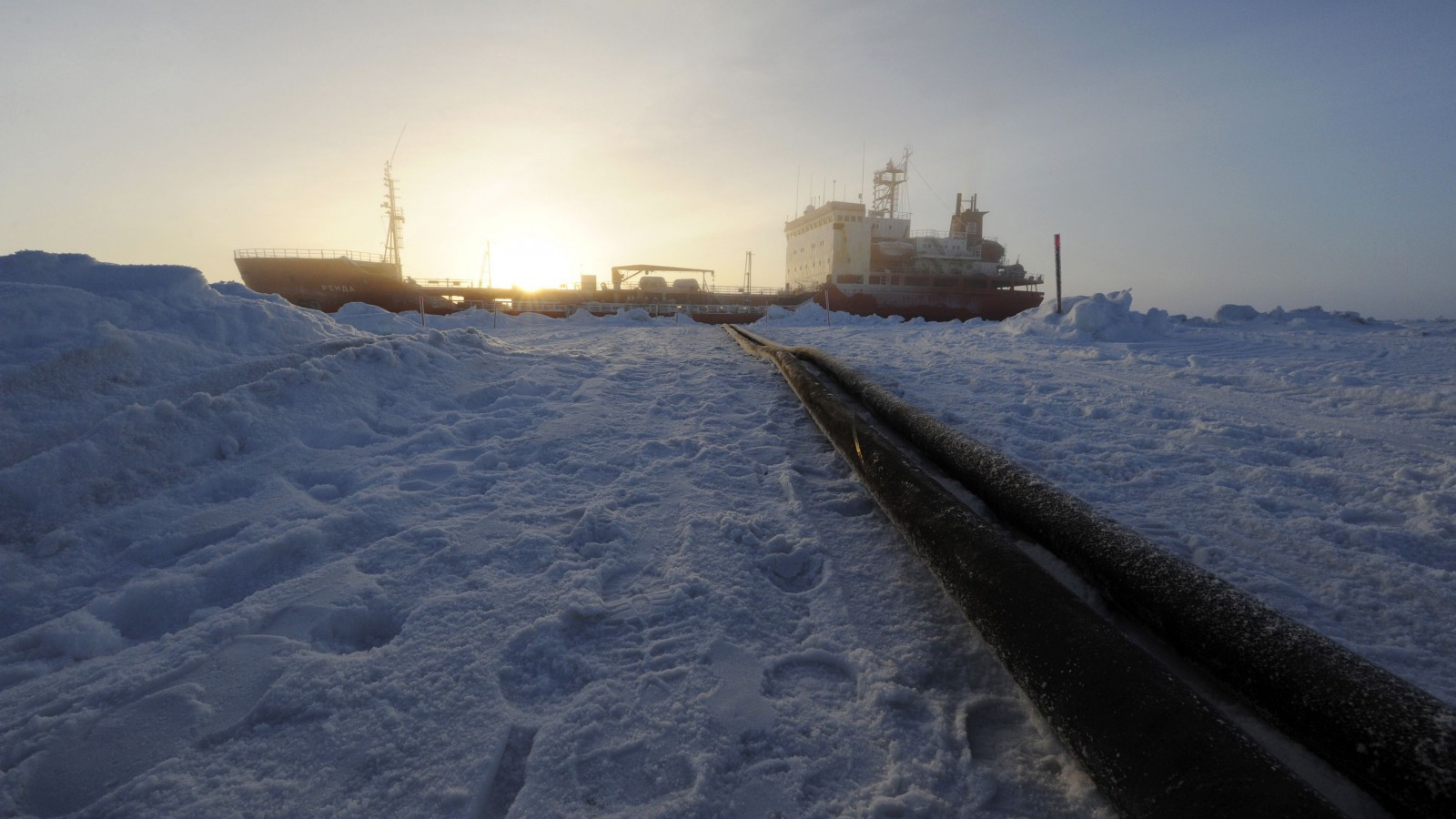 Two hoses used to transfer fuel from the Russian Russian-flagged tanker Renda are seen in Nome, Alaska, in this January 16, 2012 handout picture. Renda, the Russian tanker escorted by the U.S. Coast Guard cutter Healy, reached the frozen Alaskan port of Nome with emergency fuel supplies on January 13 after a 10-day voyage through ice-choked seas, the Russian company that owns the vessel said. David Mosley, an Anchorage-based spokesman for the U.S. Coast Guard, said the Renda would remain at least half a mile from shore, due to the shallow depth of Nome's harbor. Fuel will be delivered to Nome by hose, he said. REUTERS/U.S.  Coast Guard/Petty Officer 3rd Class Grant DeVuyst/Handout (UNITED STATES - Tags: MARITIME TRANSPORT ENVIRONMENT ENERGY) FOR EDITORIAL USE ONLY. NOT FOR SALE FOR MARKETING OR ADVERTISING CAMPAIGNS - RTR2WF51