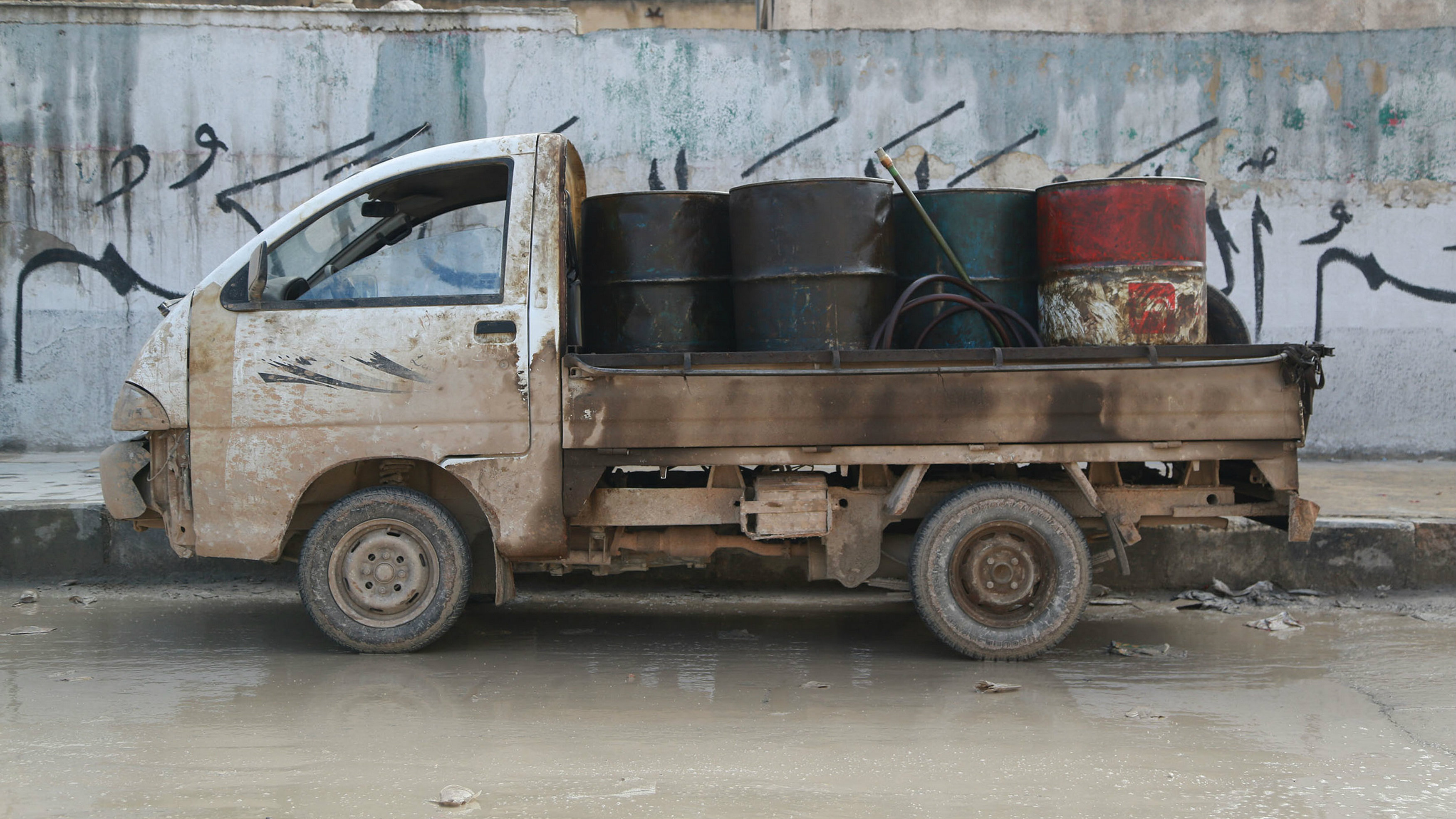 A pick-up truck carries fuel barrels for sale in the Aleppo countryside January 13, 2015.