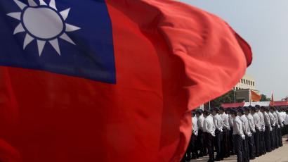 Members of the National Security Bureau take part in a drill next to a national flag at its headquarters in Taipei, Taiwan, November 13, 2015.