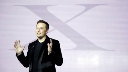 Elon Musk, CEO of Tesla Motors Inc., introduces the Model X car at the company's headquarters Tuesday, Sept. 29, 2015, in Fremont, Calif. (AP Photo/Marcio Jose Sanchez)