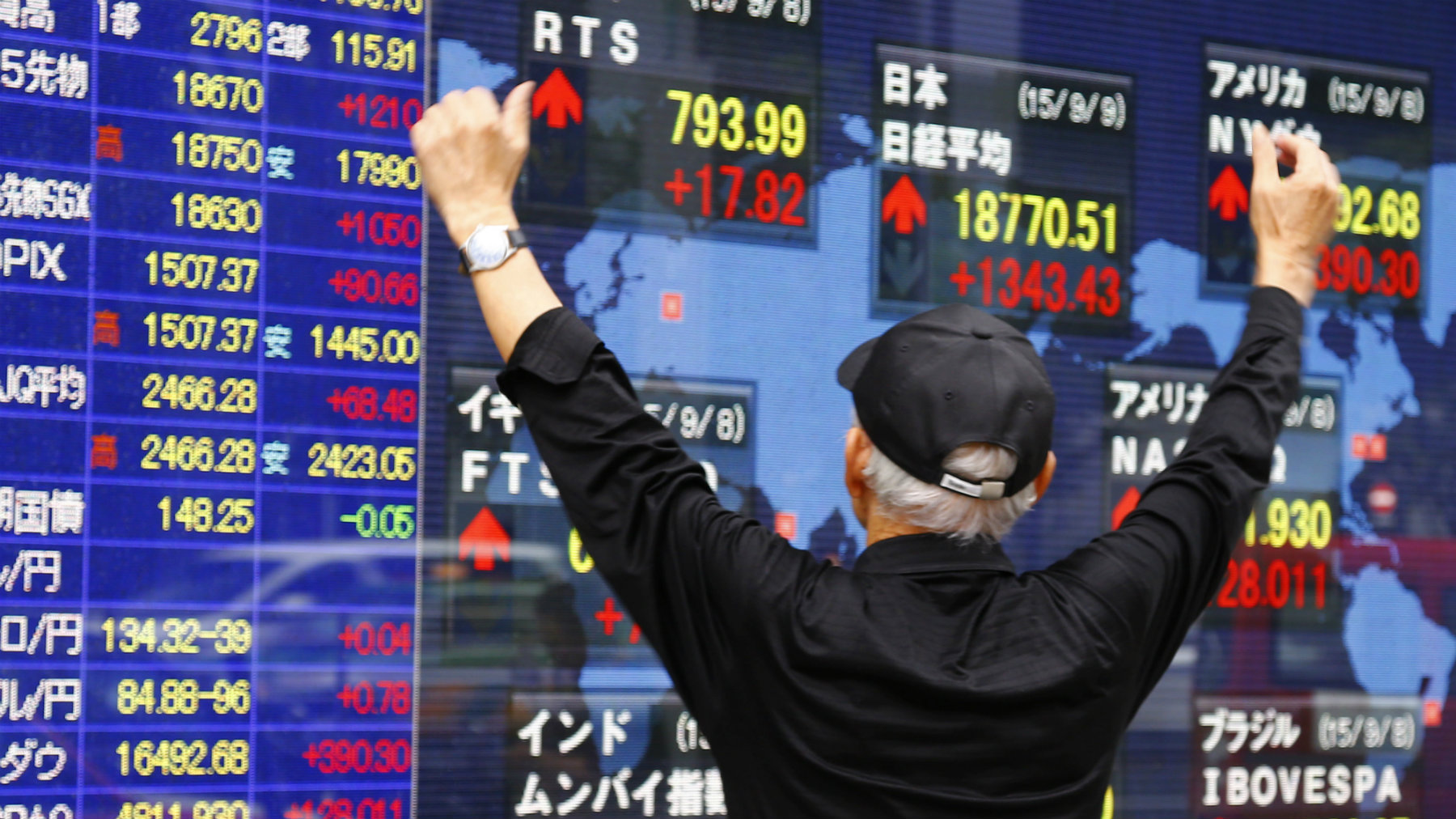 A man look at an electronic stock indicator of a securities firm in Tokyo, Wednesday, Sept. 9, 2015. Japan's Nikkei 225 stock index has surged 7.7 percent amid strong advances by other Asian markets. The Nikkei 225 index closed Wednesday up 1,343.43 points, or 7.7 percent, at 18,770.51. (AP Photo/Shizuo Kambayashi)