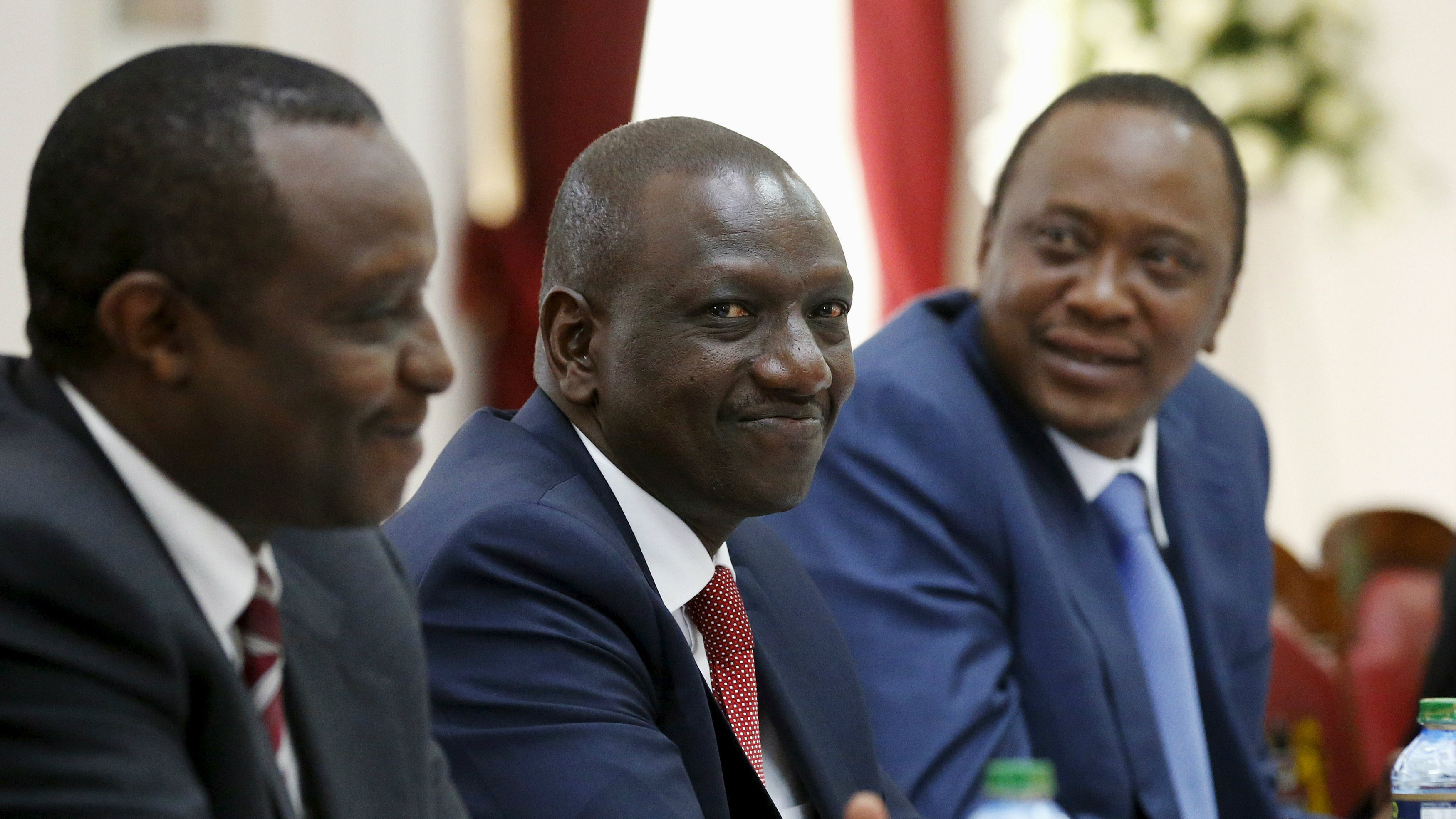 Kenya's Deputy President William Ruto (C) joins President Uhuru Kenyatta (R) for a bilateral meeting with U.S. President Barack Obama (not pictured) at the State House in Nairobi July 25, 2015.