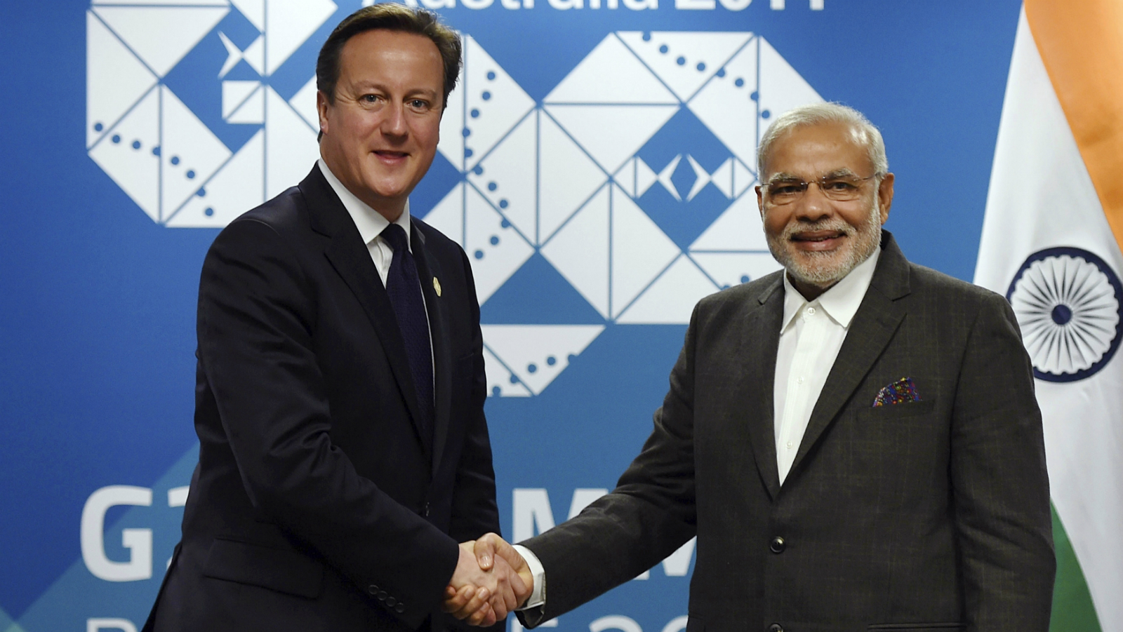 British Prime Minister David Cameron (L) meets with Indian Prime Minister Narendra Modi at their bilateral meeting before the G20 leaders Summit in Brisbane, November 14, 2014. Leaders of the top 20 industrialized nations will gather in Brisbane November 15-16 for their annual G20 summit. REUTERS/Lukas Koch/pool (AUSTRALIA - Tags: POLITICS BUSINESS)