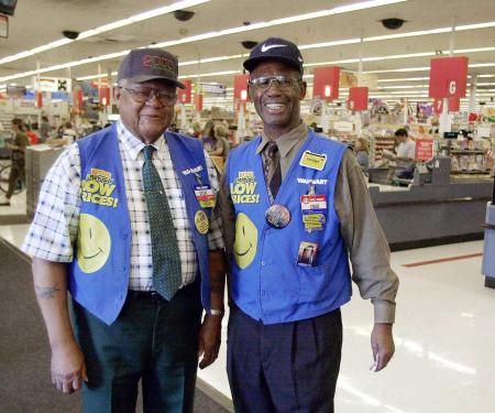 Retirees John H. Stephen, 78, left, and Louis Davis, 79, seen here on Friday afternoon, Oct. 27, 2000, work as greeters at the Wal-Mart in Tampa, Florida