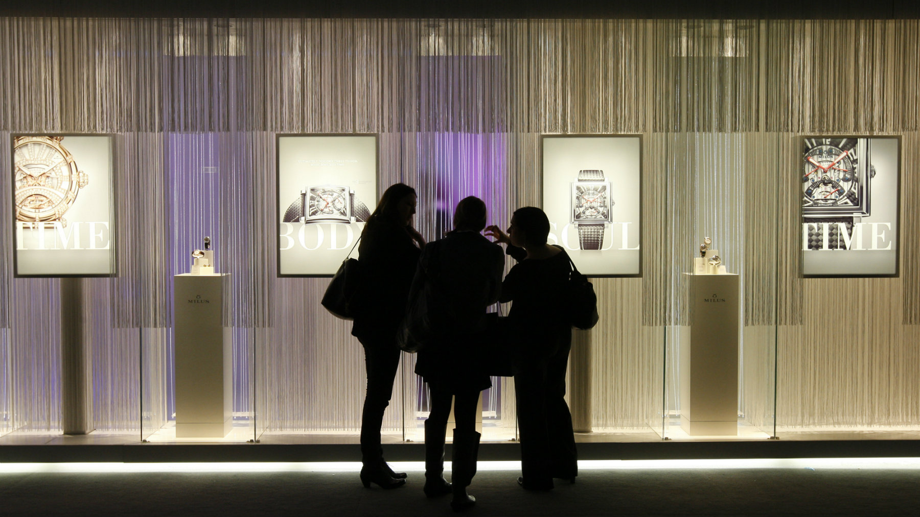 Women visit the Milus showcase on the eve of the opening of the Baselworld in Basel, Switzerland.