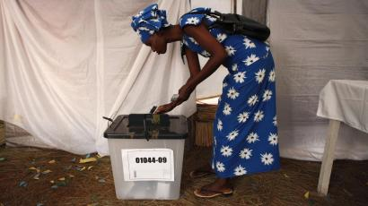 A voter casts her ballot during Rwanda's presidential election.