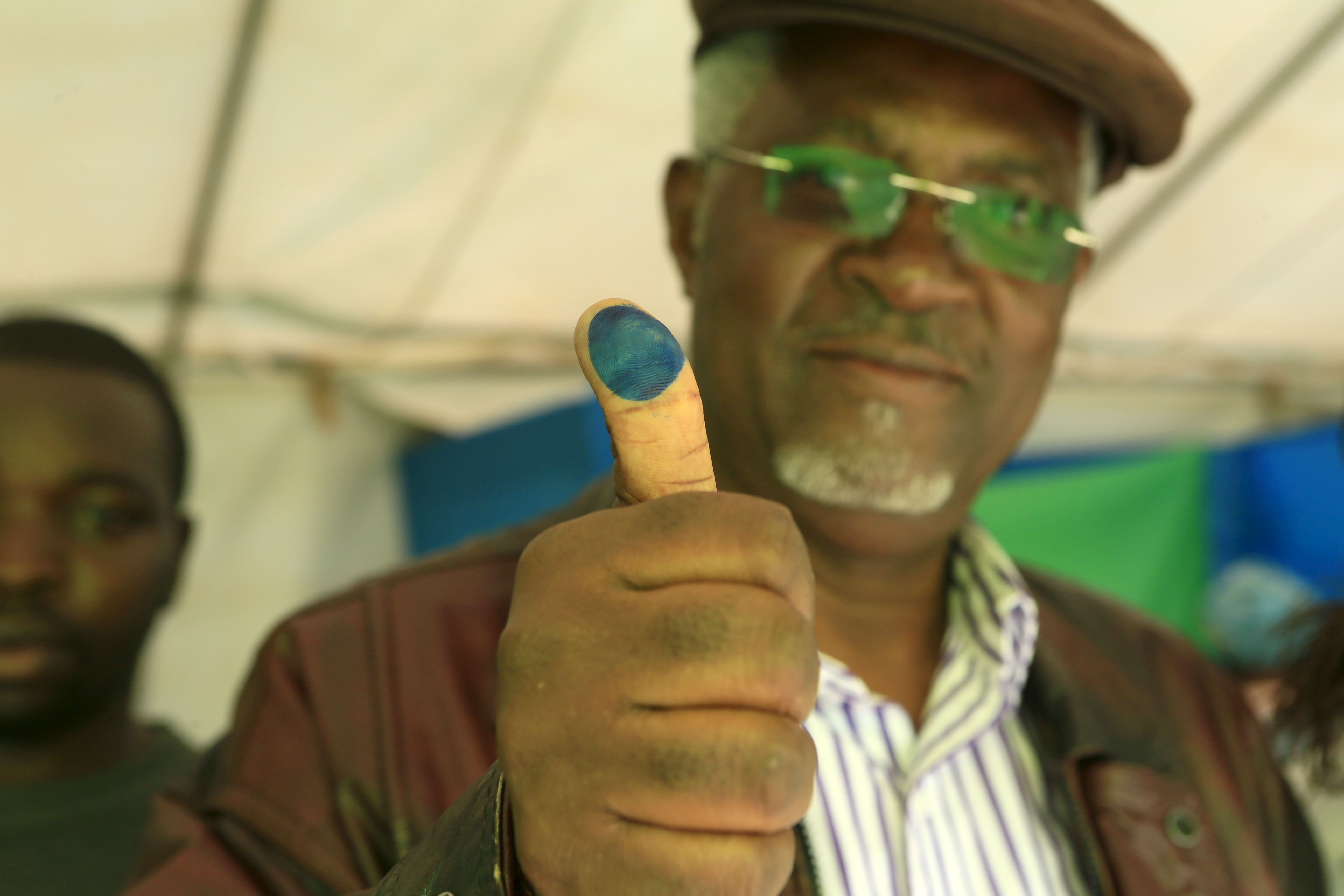 A voter shows off his inked thumb after casting vote in Rwanda's capital Kigali December 18, 2015, during a referendum as Rwandans vote to amend its Constitution to allow President Paul Kagame to seek a third term.