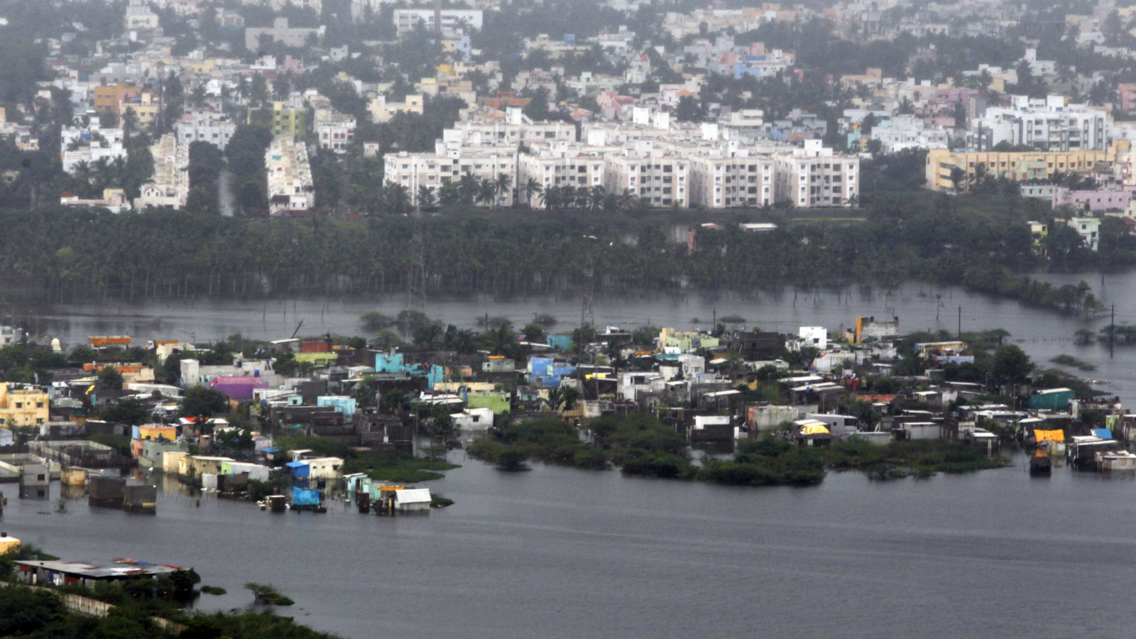 Residential areas are seen inundated by floodwaters in Chennai, India, Saturday, Dec. 5, 2015. Although floodwaters have begun to recede, vast swaths of Chennai and neighboring districts were still under 2 1/2 to 3 meters (8 to 10 feet) of water, with tens of thousands of people in state-run relief camps.