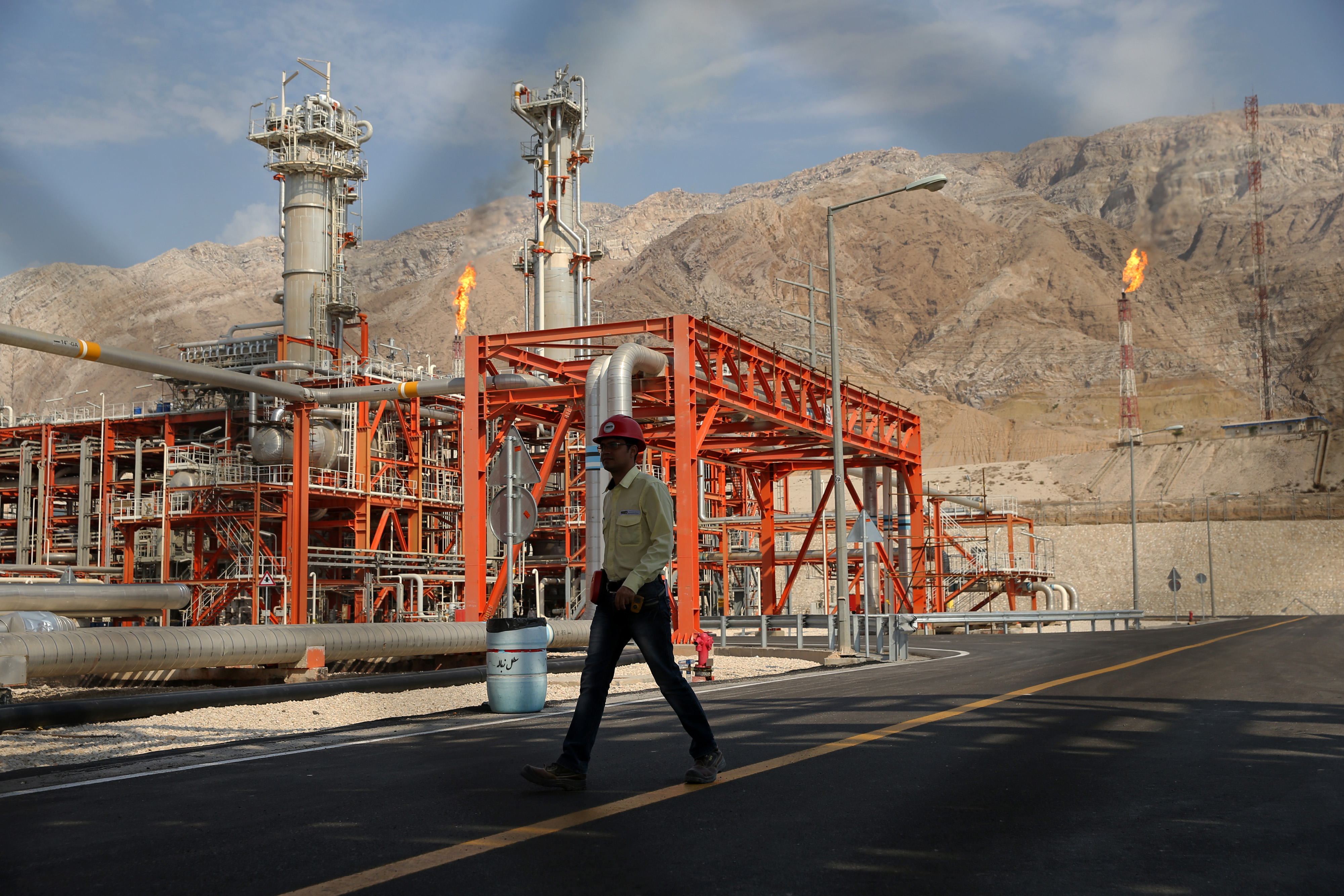 A worker makes his way in a natural gas refinery in the South Pars gas field in Asalouyeh, Iran.
