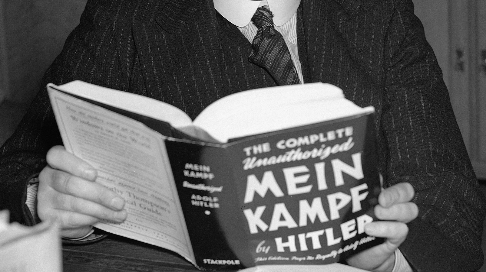 Lord Philip Lothian was announced as the new British ambassador to America in succession to Sir Ronald Lindsay, who is retiring this summer. Lord Lothian photographed reading Hitler's Mein Kampf in his office in London, on April 25, 1939. (AP Photo)