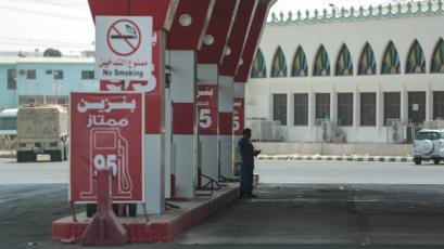 A worker waits for cars at a gas station in Mecca, Saudi Arabia.