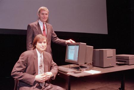 Personal computer pioneer Steve Jobs of NeXT Computer Inc., sitting, and David Norman, President of Businessland, pose beside a NeXT work station in San Francisco, Calif., on March 30, 1989.
