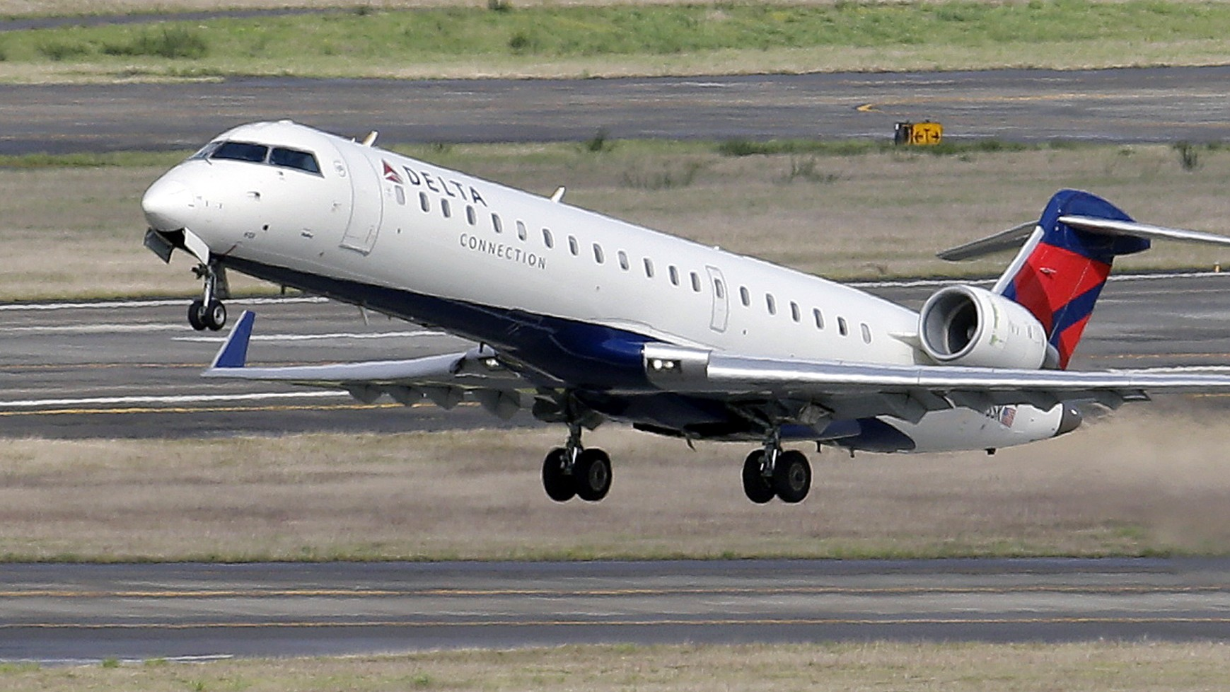 In this March 24, 2015 file photo, a Delta jet takes off from Seattle-Tacoma International Airport in SeaTac, Wash.