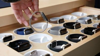 A customer picks up an Apple Watch at an Apple Store in Hong Kong Friday, April 10, 2015. From Beijing to Paris to San Francisco, the Apple Watch made its debut Friday. Customers were invited to try them on in stores and order them online. (AP Photo/Kin Cheung)