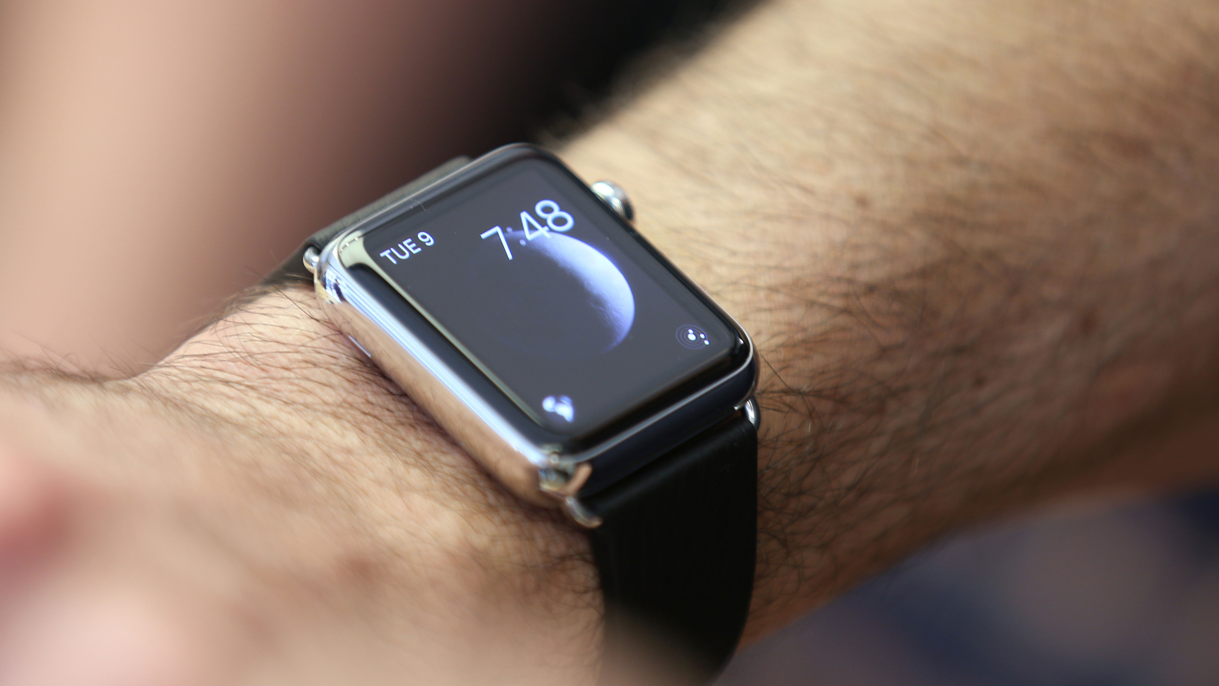 A customers wears an Apple Watch as the public have its first chance to see, touch and pre-order the watch in Sydney, Friday, April 10, 2015. Prices start at $349, but can go as high as $17,000 for a luxury edition in gold. (AP Photo/Rick Rycroft)
