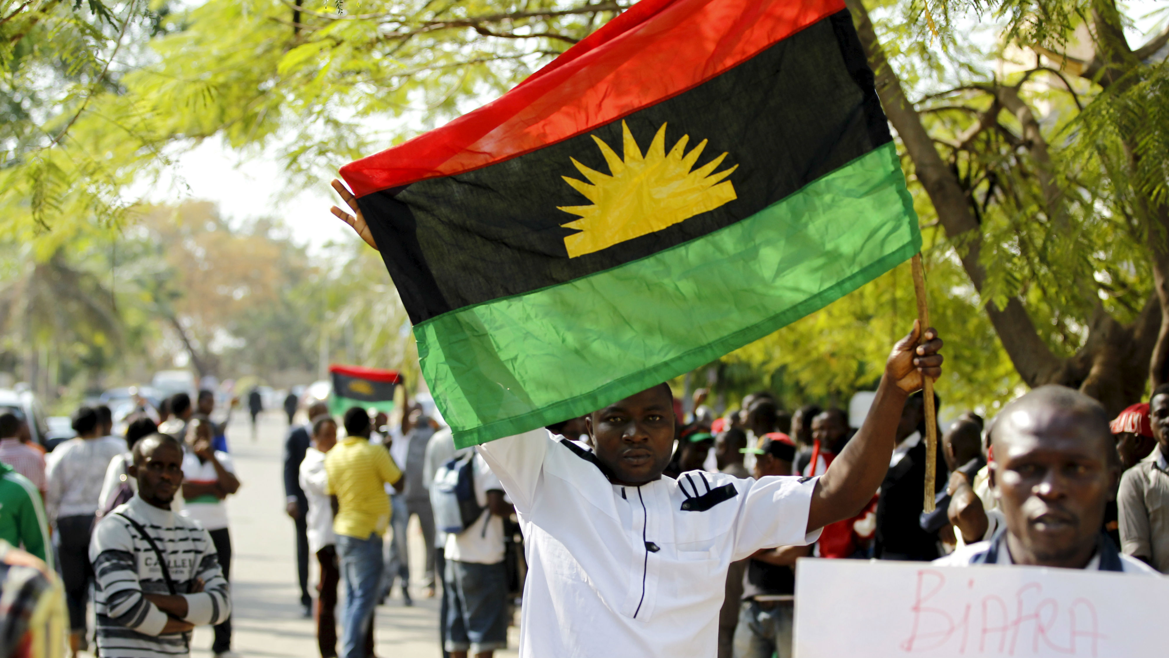 A supporter of Indigenous People of Biafra (IPOB) leader Nnamdi Kanu holds a Biafra flag during a rally in support of Kanu, who is expected to appear at a magistrate court in Abuja, Nigeria December 1, 2015. Kanu - an activist who divides his time between the UK and Nigeria, spreading his ethos on social media and Radio Biafra - was arrested on charges of criminal conspiracy and belonging to an illegal society. REUTERS/Afolabi Sotunde