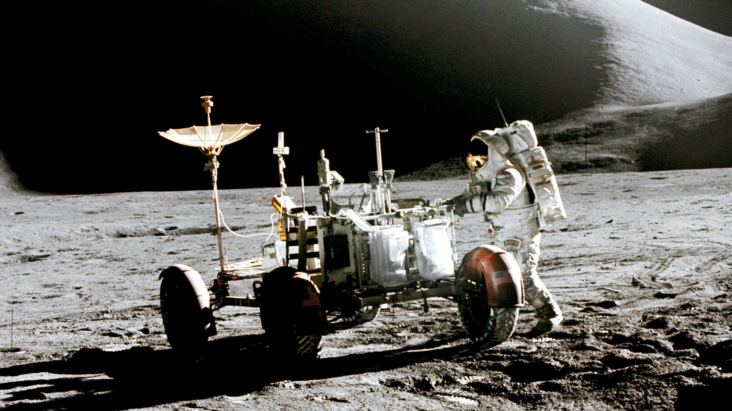 Astronaut Jim Irwin and a lunar rover on the surface of the moon in 1971.