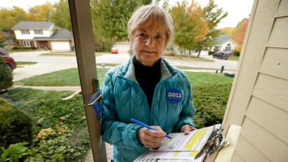 "In this photo taken Oct. 5, 2012, President Barack Obama volunteer Marilynn Wadden, of Des Moines, Iowa, stands outside her home in Des Moines. Wadden rang more than a dozen doorbells in her first hour canvassing a tidy neighborhood before stopping to take stock of her progress. Only a handful of voters were home, and, of them, only one agreed to have a ballot mailed to him so he can vote early. ""I wouldn't do this for pay. It'd be too discouraging,"" said the 70-year-old retired principal."
