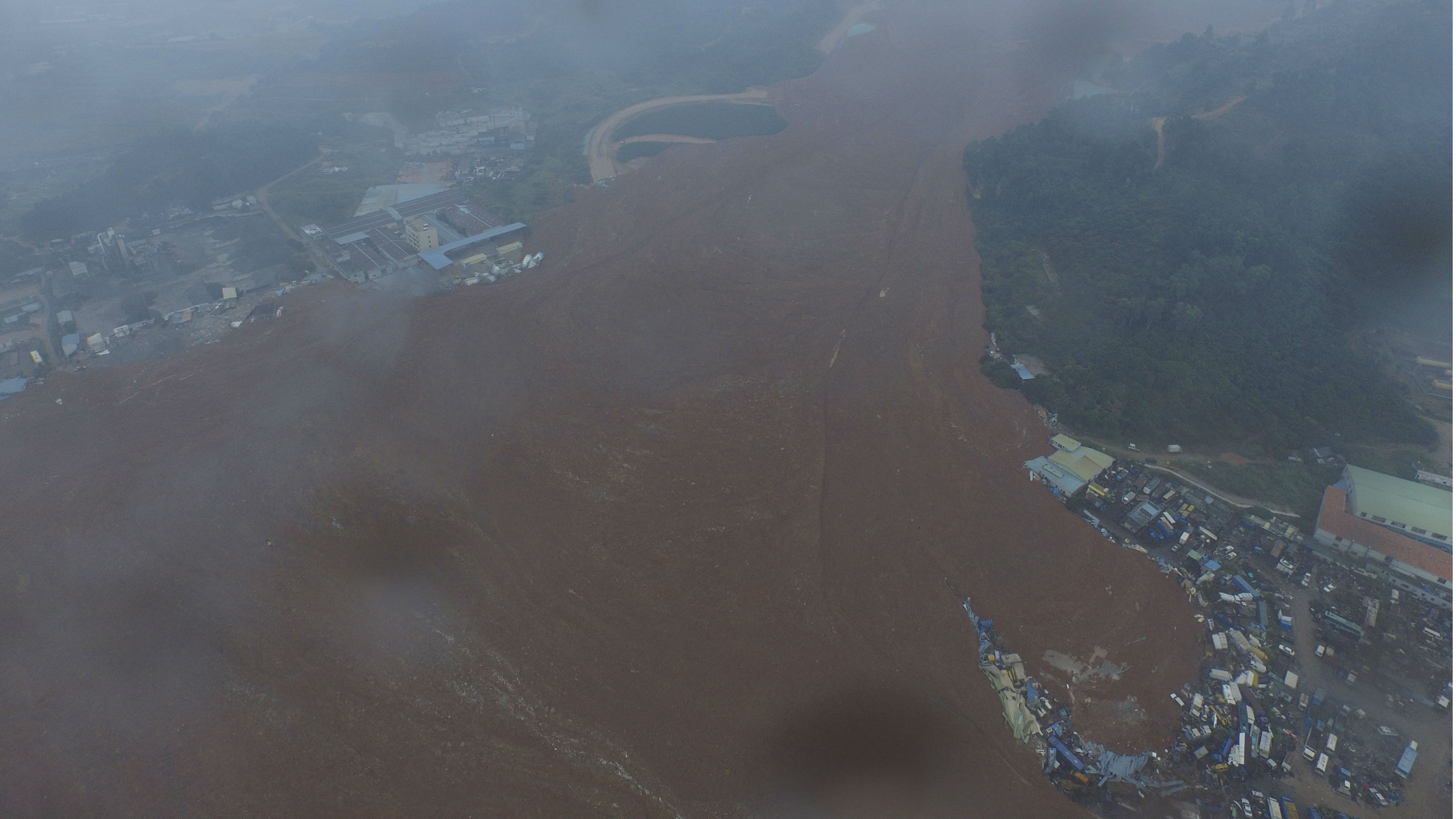 An aerial view shows the site of a landslide at an industrial park in Shenzhen, Guangdong province, China, December 20, 2015. REUTERS/Stringer