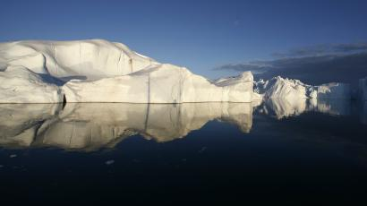 Icebergs are reflected in the calm waters at the mouth of the Jakobshavn ice fjord near Ilulissat in Greenland in this photo taken May 15, 2007.