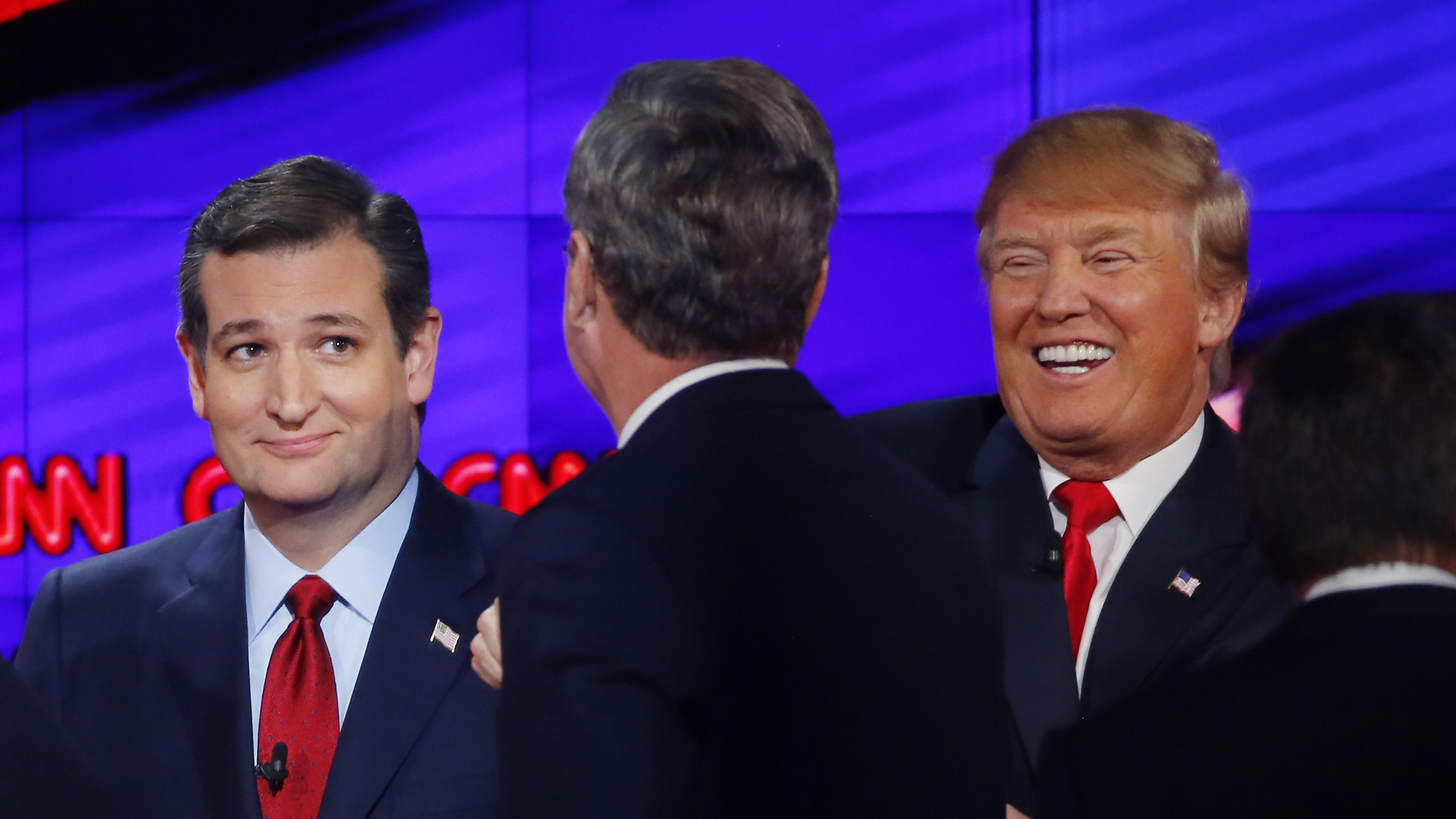 Republican U.S. presidential candidates (L-R) Senator Ted Cruz, former Governor Jeb Bush and businessman Donald Trump talk at the end of the Republican presidential debate in Las Vegas, Nevada December 15, 2015.