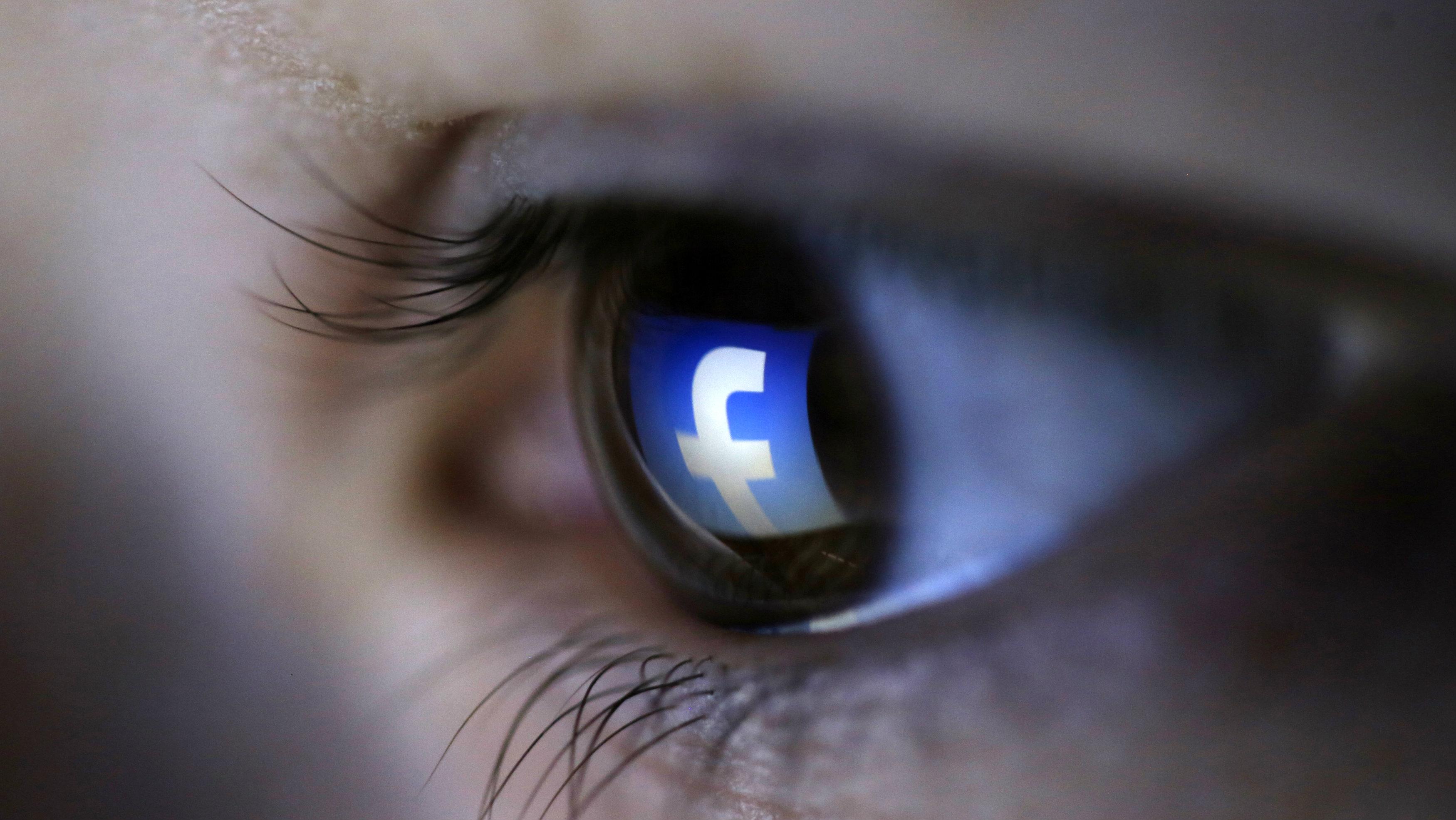 eye looking at facebook