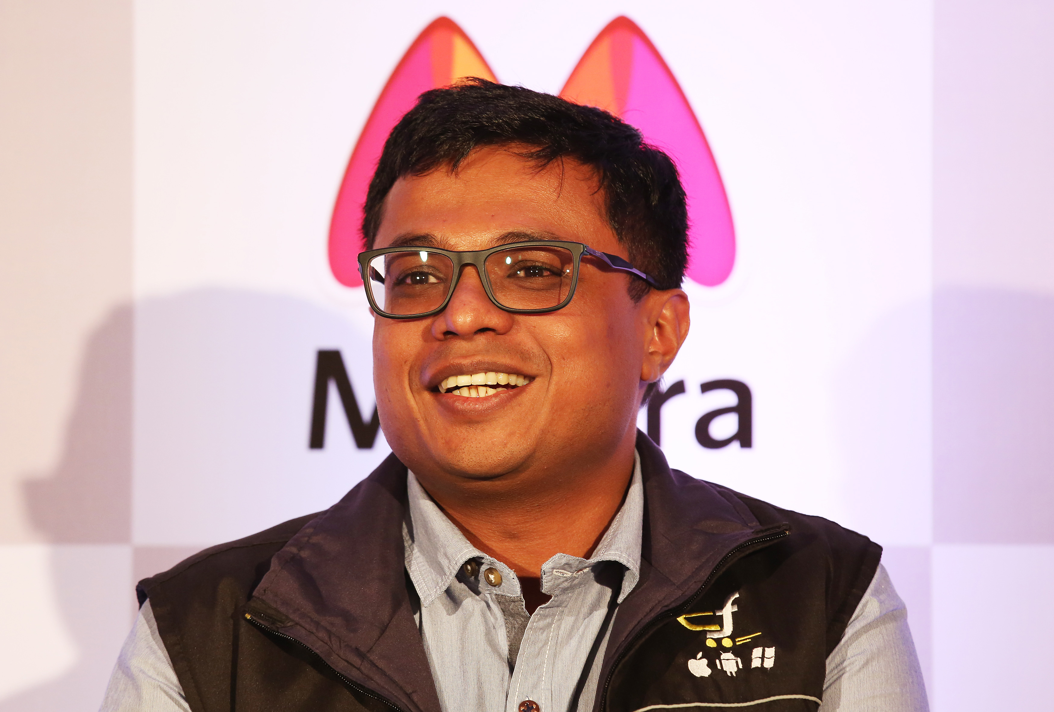 Flipkart CEO Sachin Bansal addresses a news conference in Bangalore, India, 12 May 2015. India?s e-commerce giants Flipkart and largest online fashion retailer Myntra will become a mobile app-only shopping platform starting 15 May, which intended to accelerate a consumer shift towards using smartphones to shop online, save cost and reduce dependence. The number of mobile Internet users in India is expected to reach 213 million by June, according to a 2014 report and it will be approximately 480 million mobile Internet users by end of 2017.