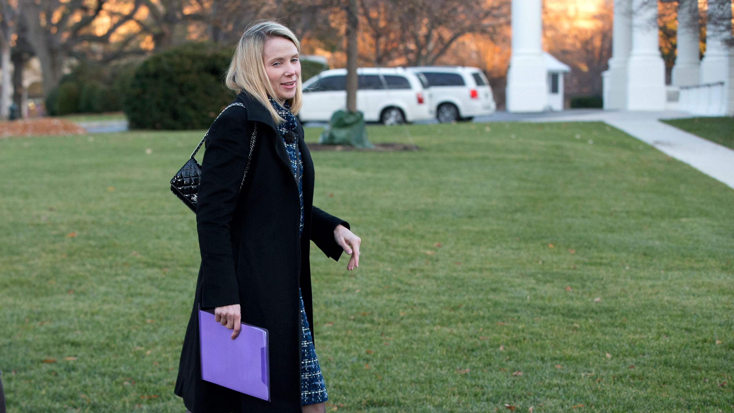 Marissa Mayer, CEO of Yahoo Inc., right, and an unidentified woman, arrive at the White House to attend a meeting of business leaders with President Barack Obama and Vice President Biden at the White House in Washington, Wednesday, Nov. 28, 2012. (AP Photo/Jacquelyn Martin)