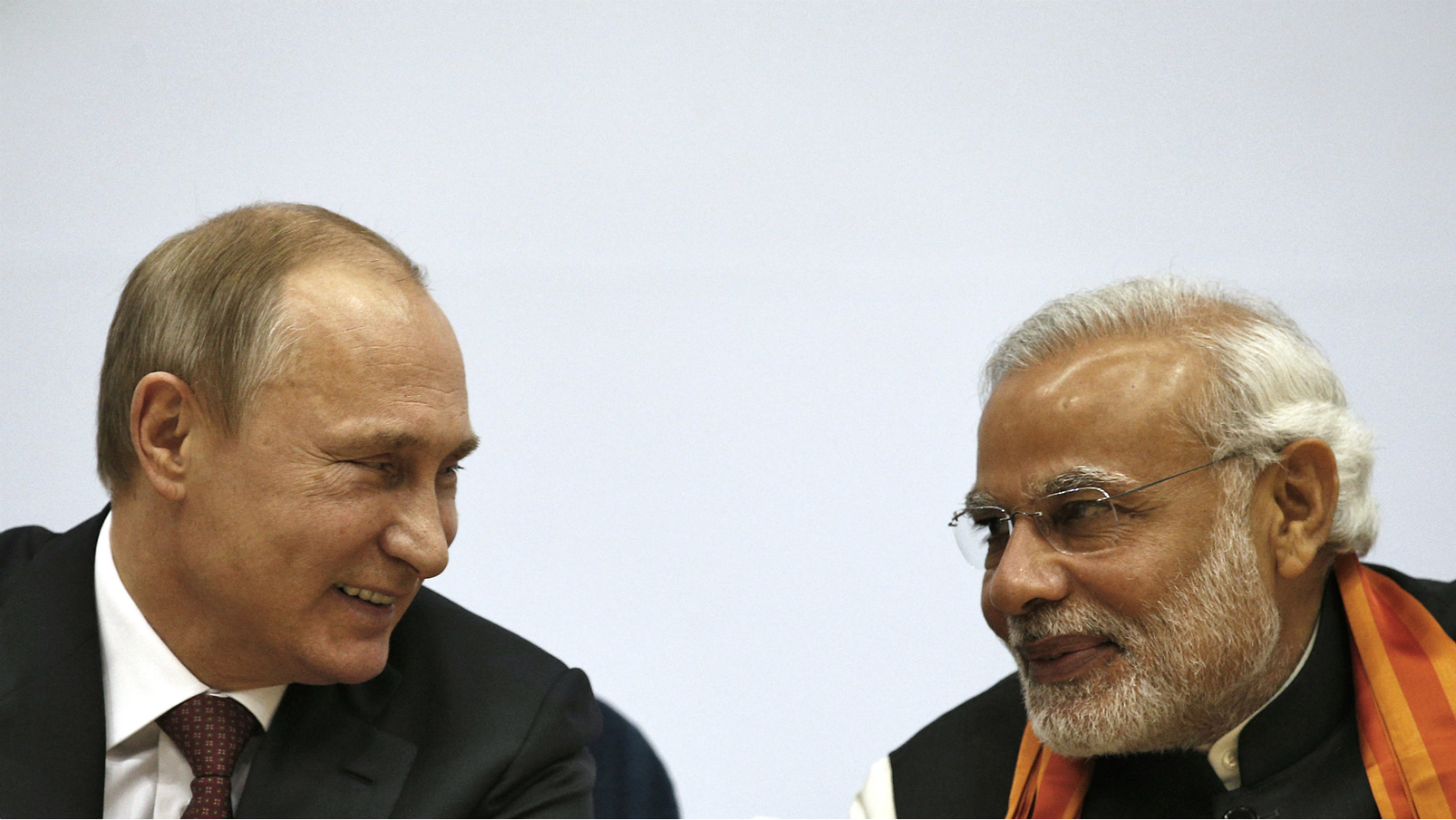 Russian President Vladimir Putin (L) and India's Prime Minister Narendra Modi smile during the inauguration of World Diamond Conference in New Delhi December 11, 2014. Modi told Putin on Thursday that Russia will remain India's top defence supplier, even though New Delhi's options had improved since the end of the Cold War.