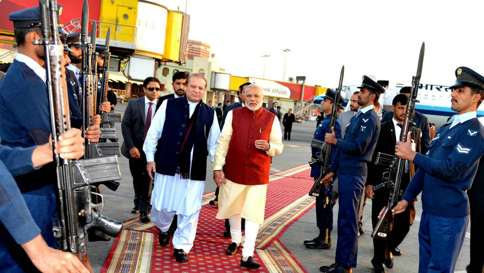 In this photo released by Press Information Department, India's Prime Minister Narendra Modi, right, reviews guard of honor with his Pakistani counterpart Nawaz Sharif in Lahore, Pakistan, Friday, Dec. 25, 2015. Modi arrived in Pakistan on Friday, his first visit as prime minister to this Islamic nation that has been India's long-standing archrival in the region.