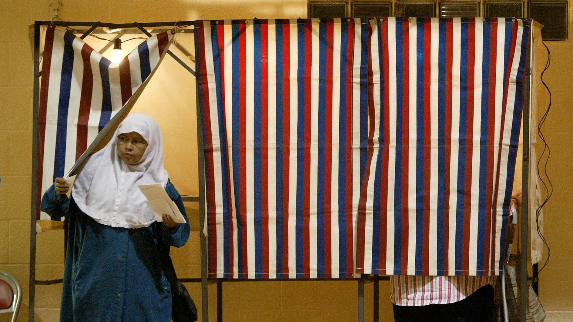 muslim woman leaving voting booth