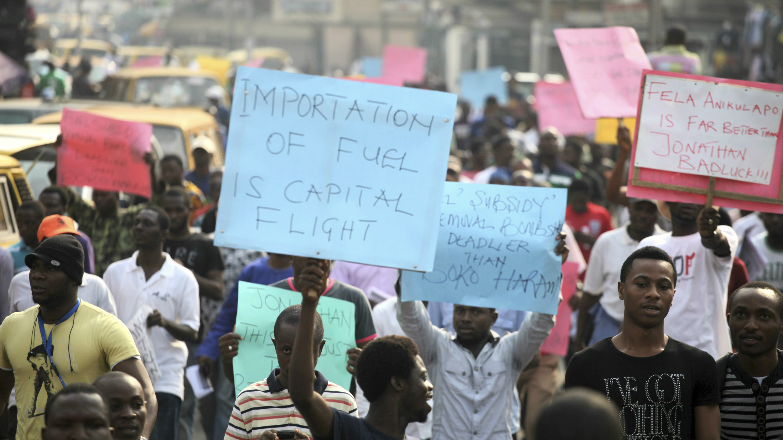 Protesters gather during a rally against fuel subsidy removal on Ikorodu road in Nigeria's commercial capital Lagos January 3, 2012. Hundreds of demonstrators in Nigeria's commercial capital Lagos shut petrol stations, formed human barriers along motorways and hijacked buses on Tuesday in protest against the shock doubling of fuel prices after a government subsidy was removed. REUTERS/Akintunde Akinleye (NIGERIA - Tags: CIVIL UNREST POLITICS ENERGY)
