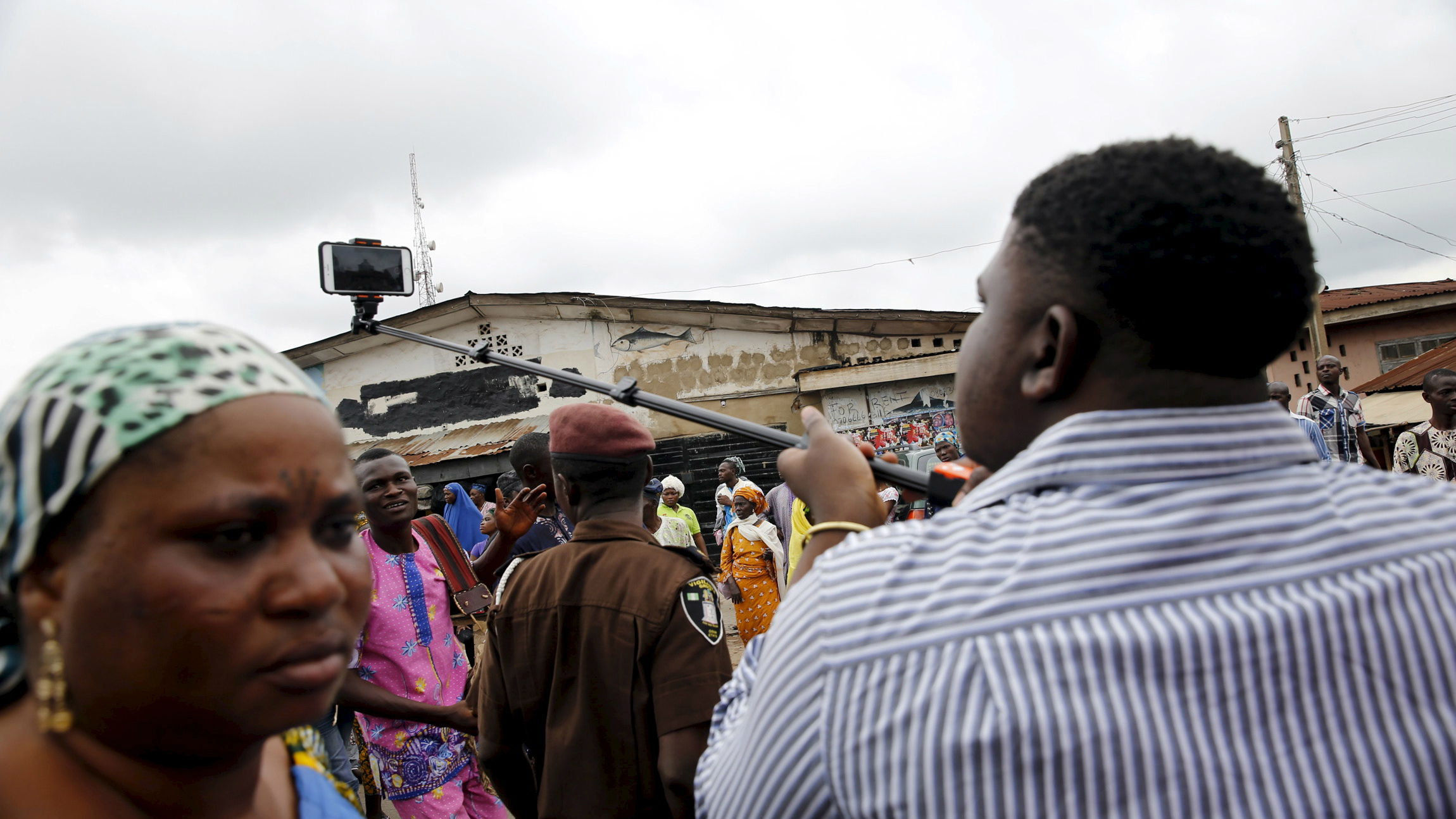 A man uses a selfie stick to film video at the start of the annual Osun festival in Osogbo in Nigeria's southwest, August 10, 2015. REUTERS/Akintunde Akinleye
