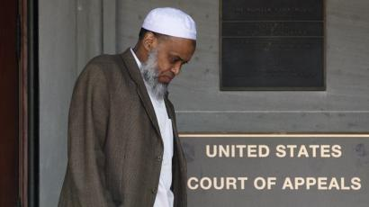 FILE - This May 11, 2012 file photo, Portland Imam Mohamed Sheikh Abdirahman Kariye, who is one of 15 men who say their rights were violated because they are on the U.S. government's no-fly list, leaves the United Sates Court of Appeals following oral arguments on the ACLU No Fly List challenge, in Portland, Ore. A federal judge has ruled Tuesday, June 24, 2014, that the U.S. government violated the rights of 13 people on its no-fly list by depriving them of their constitutional right to travel, and gave them no adequate way to challenge their placement on the list.