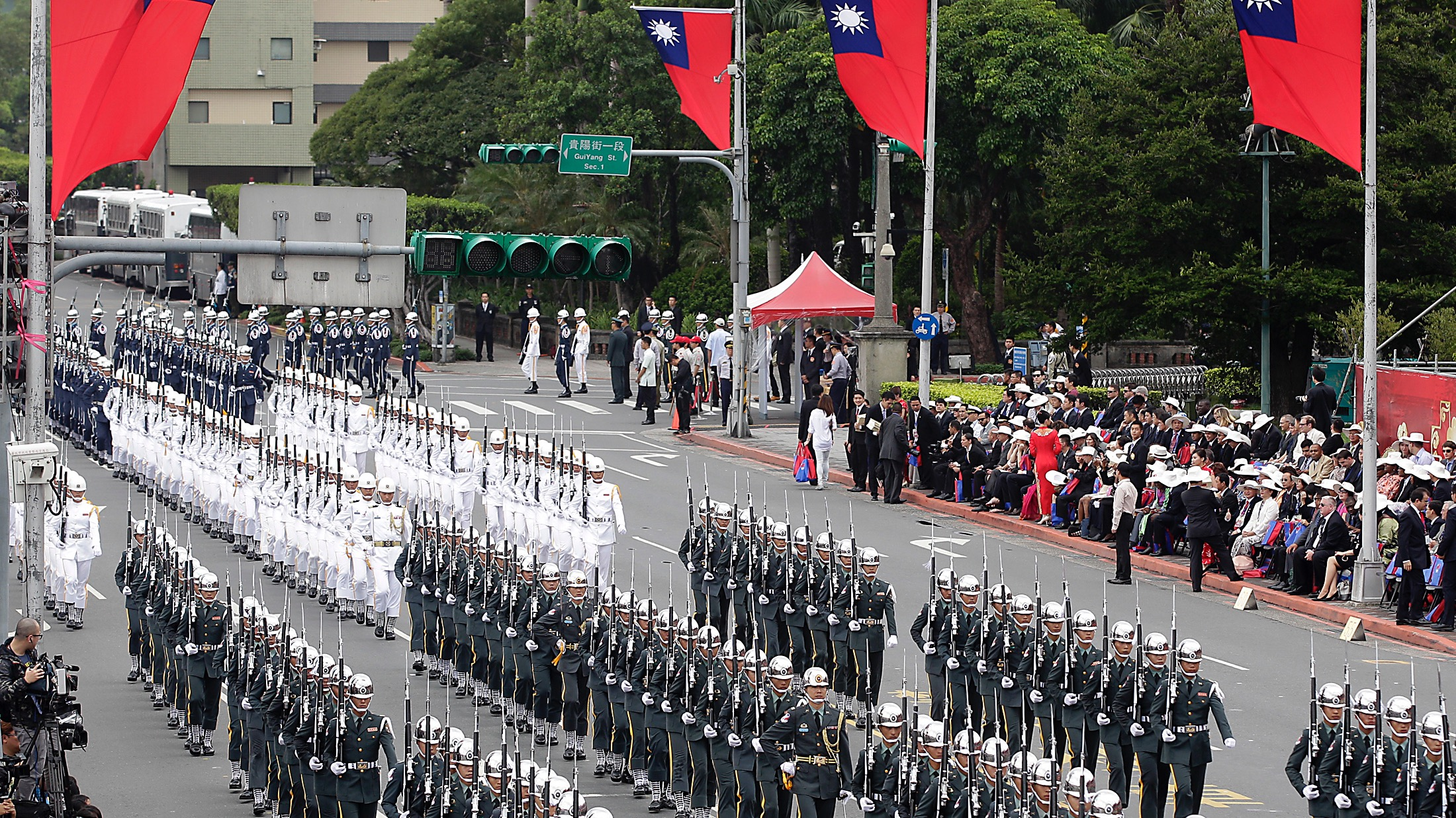 Military honour guards take part in Taiwan's National Day celebrations in front of the Presidential Office in Taipei