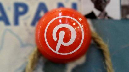 In this April 1, 2015 photo. a pin signifies Pinterest's Japan offices on a map at the Pinterest office in San Francisco. Pinterest users will be able to buy items they like using a new type of pin, e-commerce company Shopify said Tuesday, June 2, 2015. (AP Photo/Jeff Chiu)