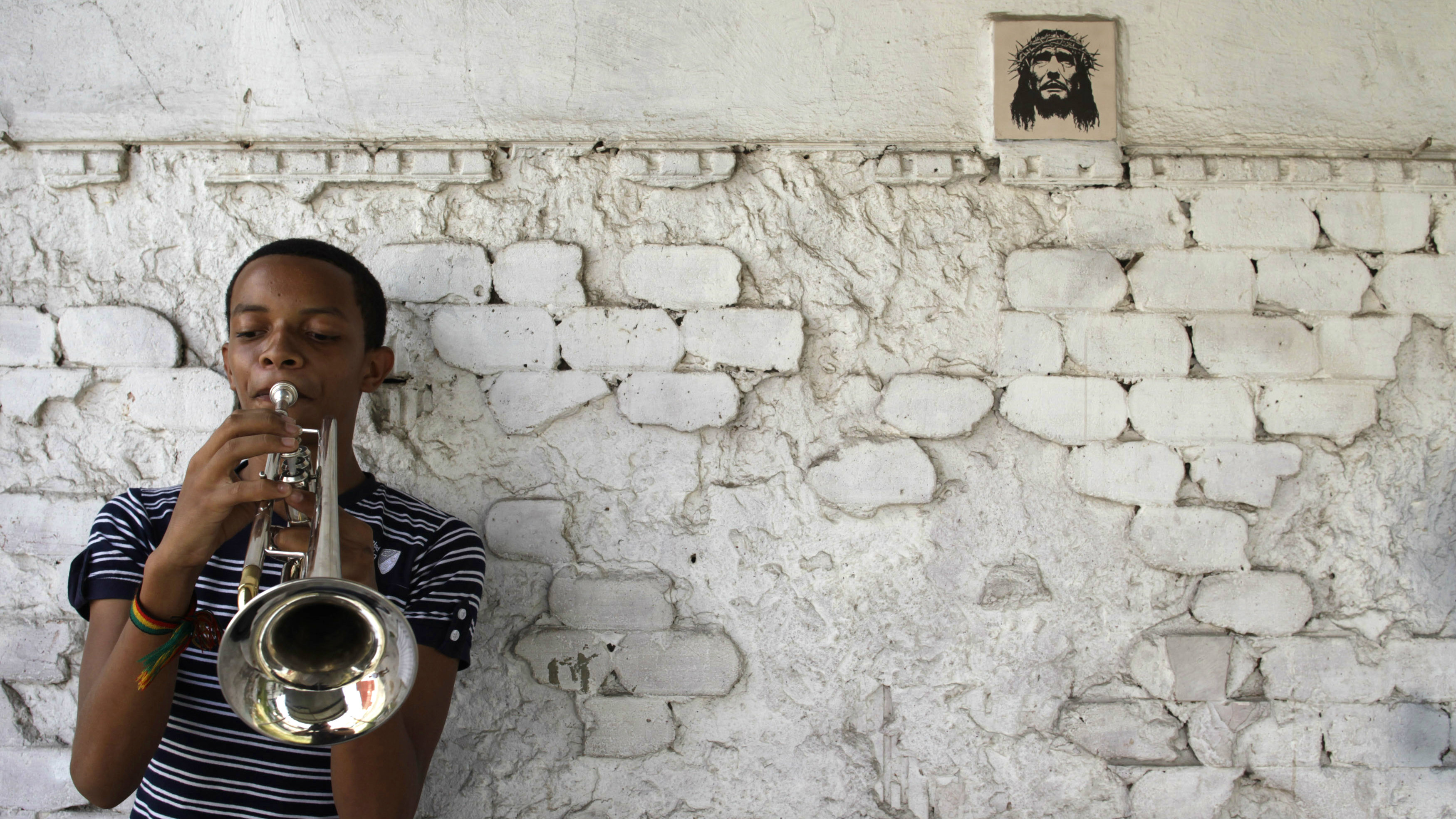 Pablo Mures, 14, a member of the Junior Jazz band from the Danilo Perez Foundation, practises his trumpet on a street in a low-income neighbourhood in Santa Ana in Panama City April 26, 2013. The foundation, an outreach music project, teaches music to children and adolescents living in poverty and high risk neighbourhoods such as El Chorrillo, San Miguelito and Santana. It aims to provide opportunities for youths who have been abandoned by their families, affected by, or are at risk of being involved in drugs, gangs and violence. The Junior Jazz band, formed over three years ago, is made up of six musicians from 12 to 14 years old. The band has performed at the Panama Jazz festival and was the opening band for international jazz musicians such as Ruben Blades and Herbie Hancock. Picture taken on April 26, 2013. REUTERS/Carlos Jasso