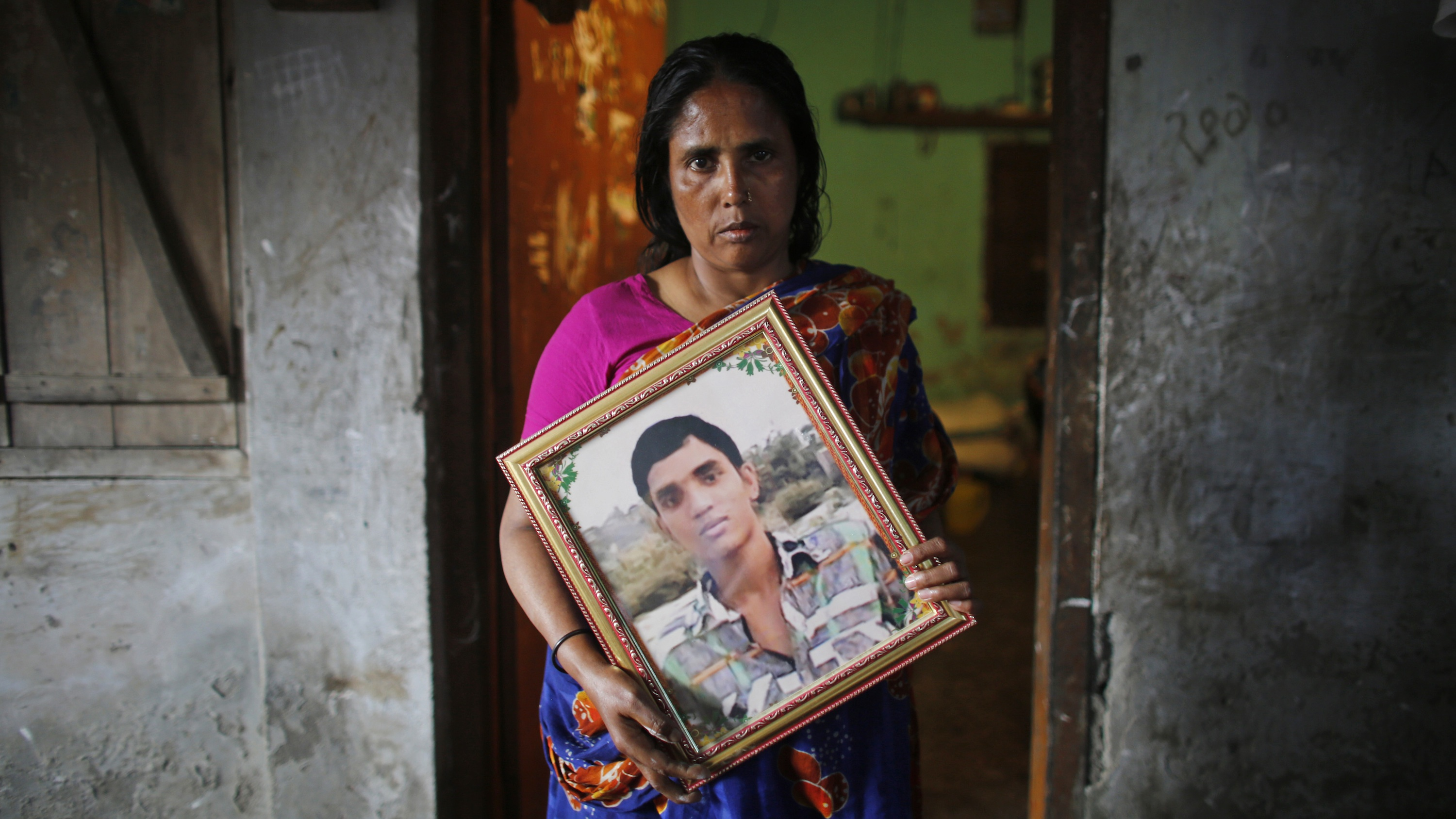 Fatema holds a picture of her son Nurul Karim, who died when  the Rana Plaza factory collapsed in 2013.
