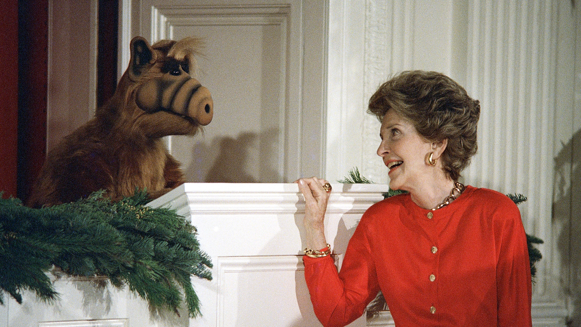 First lady Nancy Reagan glances towards ALF, an alien life form, during a Christmas party for Children of Washington's diplomatic corp at the White House Monday.