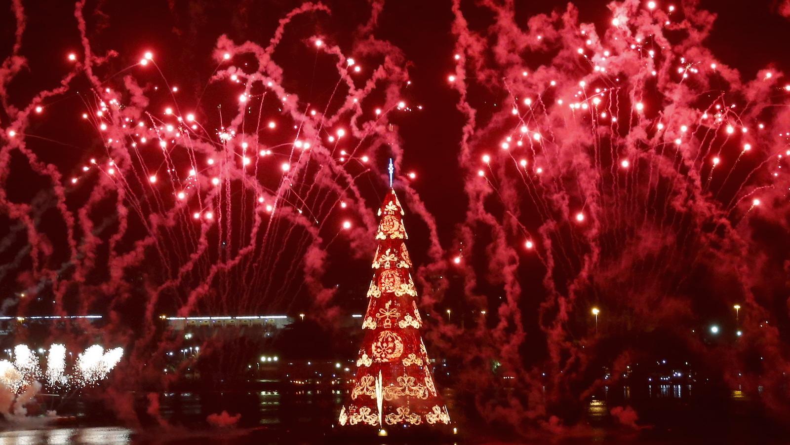 Fireworks explode around Rio's Christmas tree during its lighting ceremony at Rodrigo de Freitas Lagoon in Rio de Janeiro, Brazil