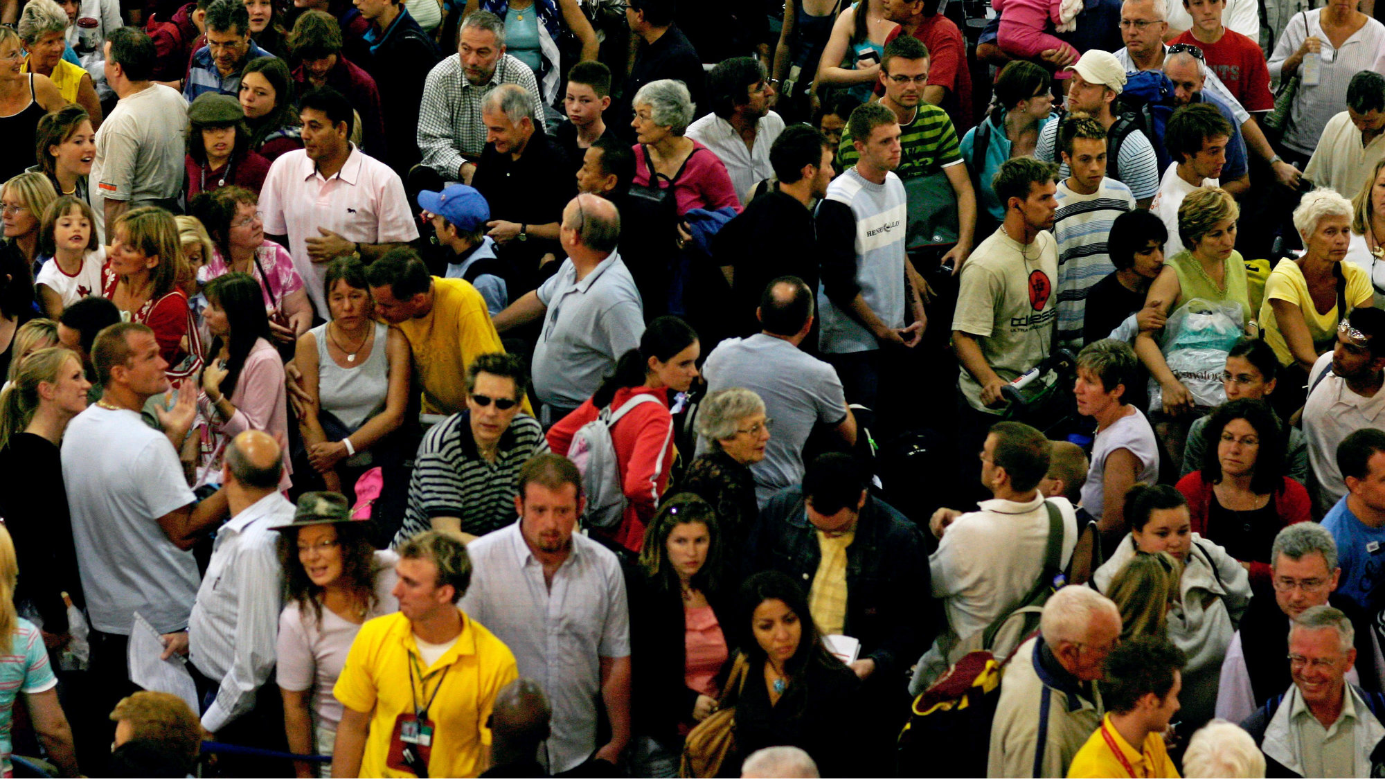 Travellers queue at Gatwick international airport on the outskirts of London.