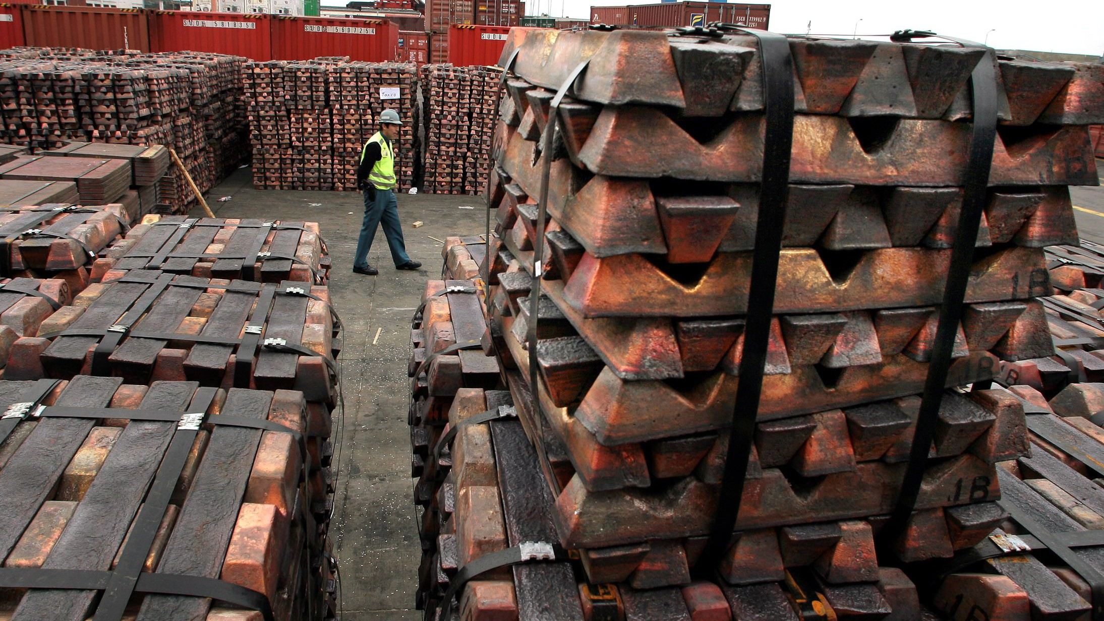 A security guard walks past a shipment of copper that is to be shipped to Asia in  Valparaiso port in Chile