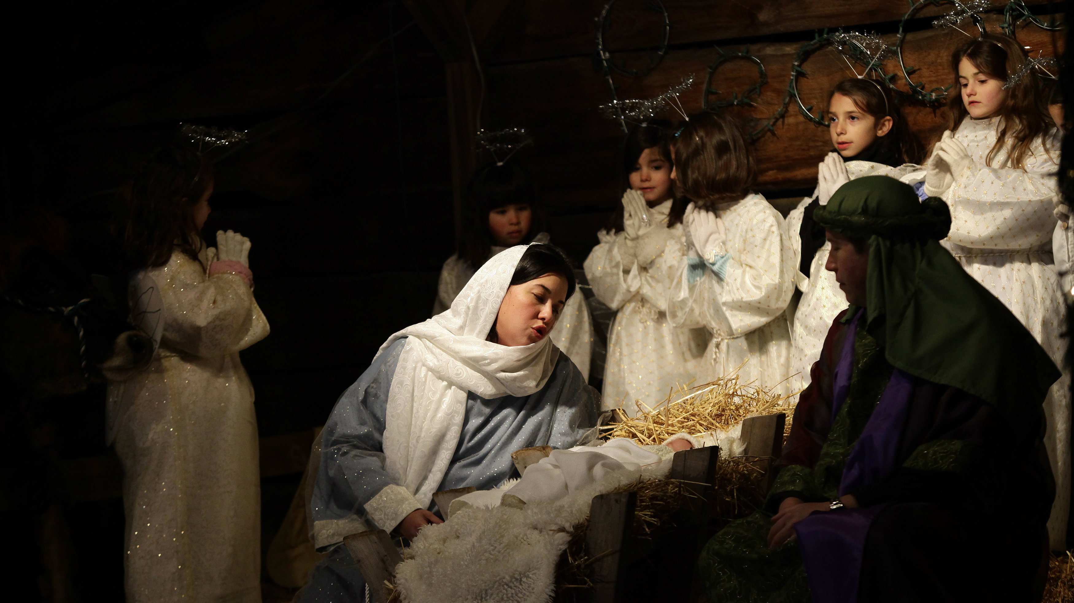 A recreation act from the Christmas Nativity Scene is re-enacted outside Saint Rose of Lima Roman Catholic Church.