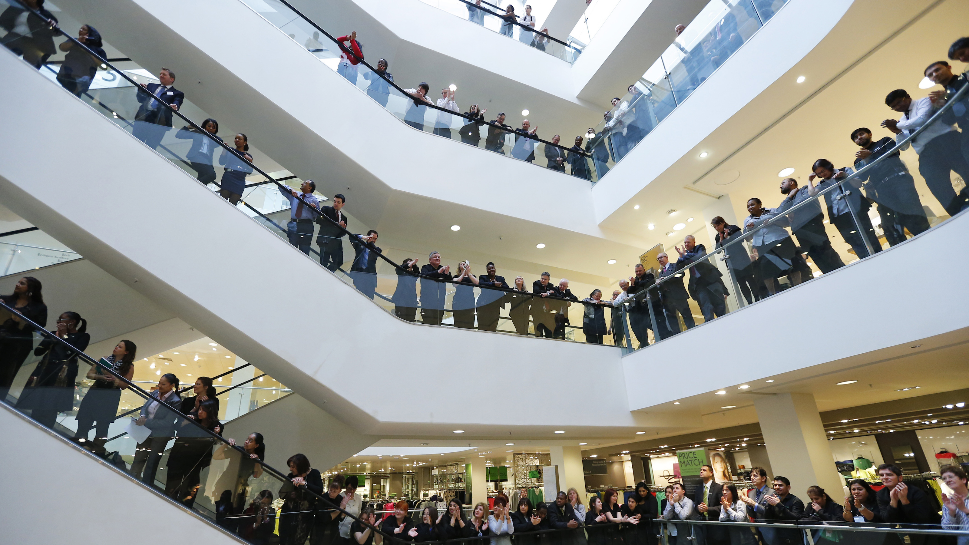 """Workers, known as partners at the John Lewis Partnership, celebrate after the announcement of their annual profit related bonus, at their flagship Oxford Street store in central London March 7, 2013. British retailer, the John Lewis Partnership, said on Thursday it would pay its staff a bonus of 17 percent of salary after it outperformed rivals with a 16 percent rise in annual profit. """"We expect our sales growth to continue this year, albeit less strongly than in 2012-13, and we are planning a significant step up in total investment, with a particular focus on our supply chain, technology and systems,"""" Chairman Charlie Mayfield said. REUTERS/Andrew Winning (BRITAIN - Tags: BUSINESS SOCIETY EMPLOYMENT) - RTR3EOLQ"""
