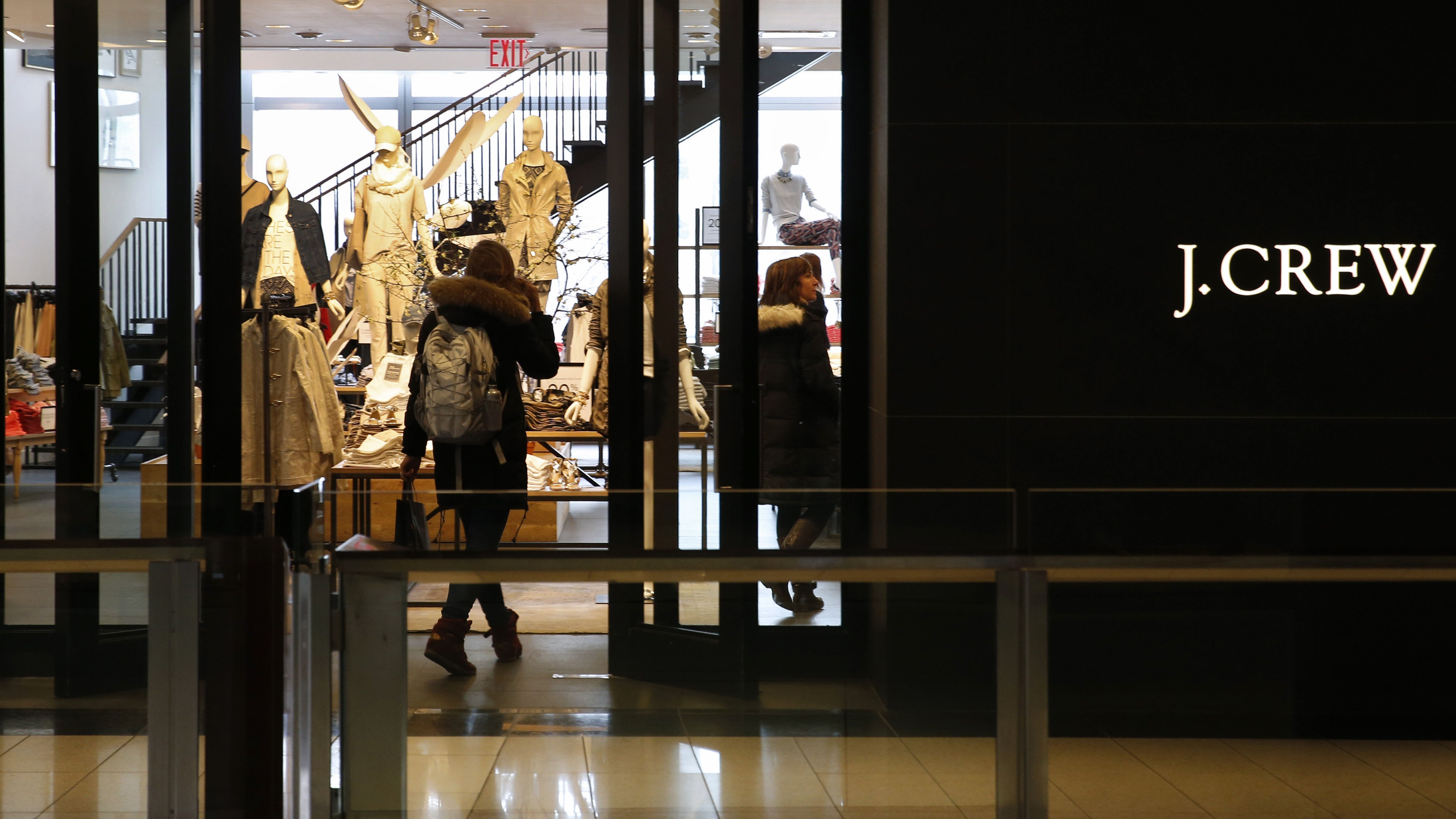 A customer walks into a clothing retailer J.Crew store in Manhattan, New York, March 3, 2014.