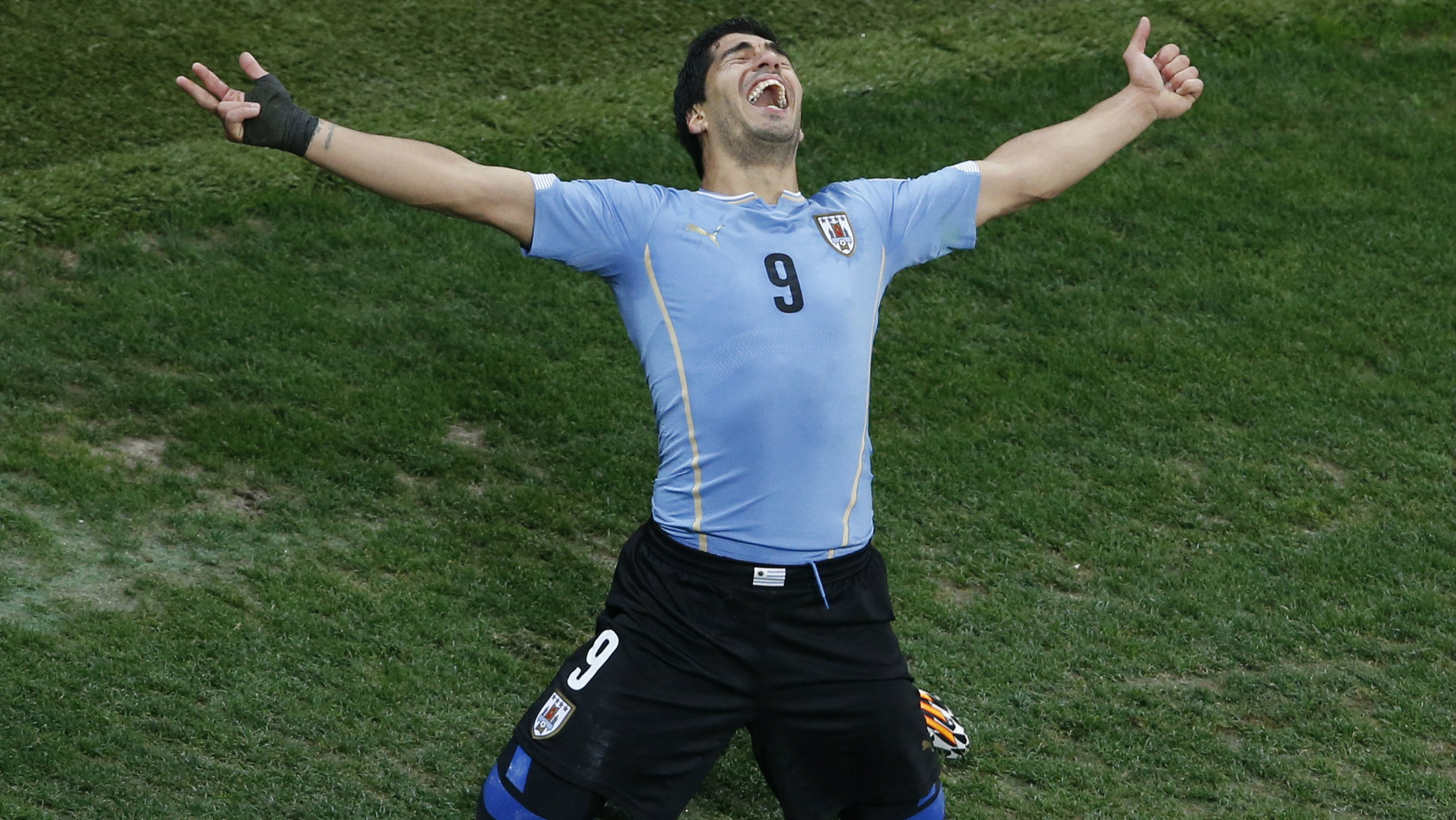 Uruguay's Luis Suarez celebrates scoring his team's second goal against England during their 2014 World Cup Group D soccer match.