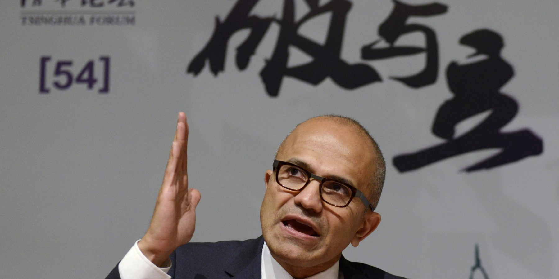 Microsoft Chief Executive Satya Nadella gestures as he speaks during a forum at Tsinghua University in Beijing September 25, 2014. REUTERS/China Daily (CHINA - Tags: BUSINESS SCIENCE TECHNOLOGY EDUCATION) CHINA OUT. NO COMMERCIAL OR EDITORIAL SALES IN CHINA - RTR47MJY