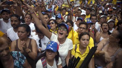 Opposition supporters shout during a rally in support of the political leaders in prison in Caracas